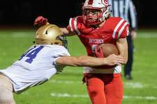 Guilderland running back Justin Kapursinsky tries to fight off CBA defender Brenden Simek during a Class AA matchup at Guilderland High School on Friday, Oct. 22, 2021. (Jim Franco/Special to the Times Union)