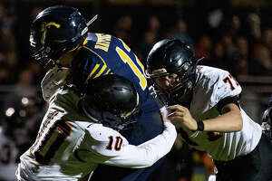 The Ubly varsity football team finished the 2021 MHSAA season with a perfect 9-0 record on Friday night, picking up a hard-fought victory at Bad Axe. The Bearcats won, 25-13.