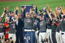The Astros celebrate as they win the American League Championship Series and advance to the World Series on Friday, Oct. 22, 2021 at Minute Maid Park in Houston.