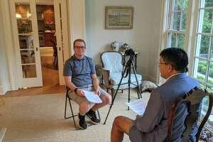 Student Evan Papageorge interviews candidate Ken Astarita.