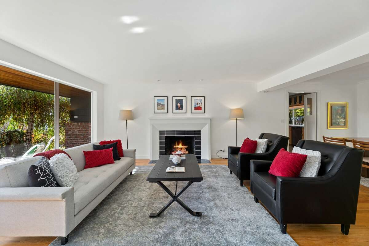 A fireplace warms the living room.