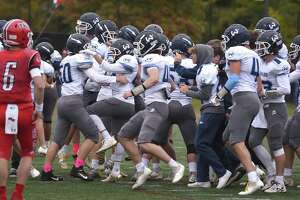 Wilton celebrates its first football win over New Canaan since 1995 at Dunning Field on Saturday in New Canaan.
