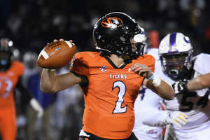 Edwardsville quarterback Jake Curry prepares to throw a pass down the field during the second quarter against CBC on Friday.