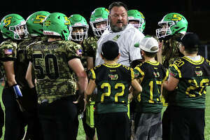 Southwestern coach Pat Keith talks with his team during a timeout in a Sept. 17 game at Knapp Field in Piasa. The Piasa Birds finished the regular season at 5-4 and will make their first playoff appearance since 2009 when they play at Benton.