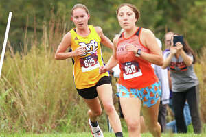 CM's Hannah Meiser (left) runs behind Waterloo's Angelynn Kanyuck at the MVC Meet on Oct. 14 at Principia College in Elsah. On Saturday in Alhambra, Kanyuck finished first with Meiser second in the Highland Class 2A Regional.