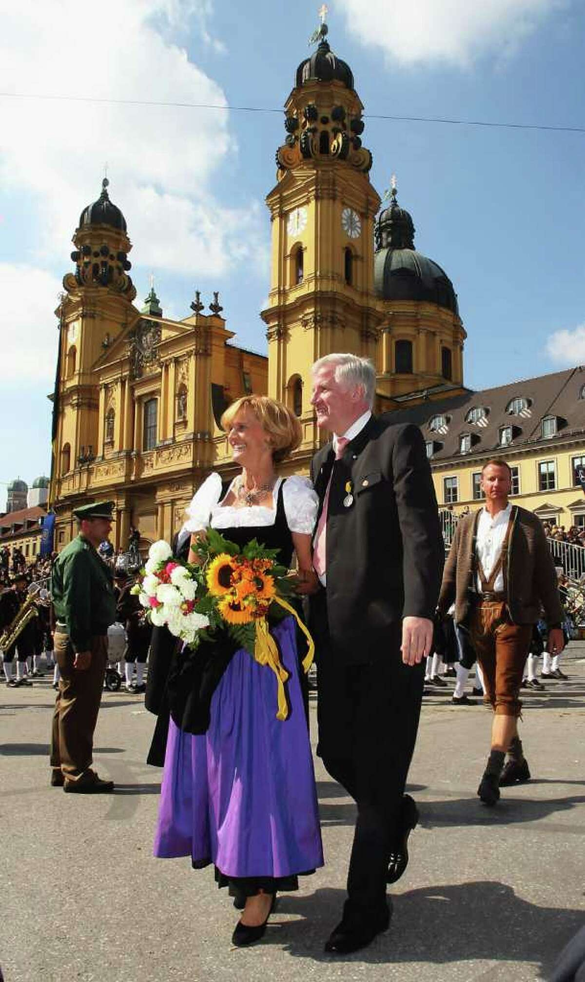 MUNICH, GERMANY - SEPTEMBER 19: Bavarian state premier Horst Seehofer (R) and his wife Karin participate in the traditional riflemen's parade of the Oktoberfest on September 19, 2010 in Munich, Germany. 2010 marks the 200th anniversary of Oktoberfest.The Oktoberfest tradition started in 1810 to celebrate the October 12th marriage of Bavarian Crown Prince Ludwig to the Saxon-Hildburghausen Princess Therese. The citizens of Munich were invited to join in the festivities which were held over five days on the fields in front of the city gates. The main event of the original Oktoberfest was a horse race. The world's biggest beer festival will last this year from September 18 to October 4. (Photo by Alexandra Beier/Getty Images) *** Local Caption *** Horst Seehofer;Karin Seehofer