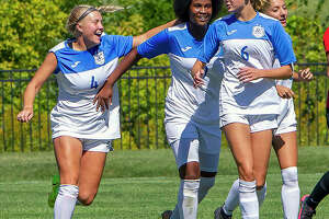 LCCC's Skylar Hollinghead (4), Chrissy Mitchell, center, and Kaya Thies (6) celebrate a goal against Wabash Valley on Sept. 25 in Godfrey. LCCC will play host to Wabash Valley at 2 p.m. Tuesday in a Region 24 Tournament semifinal.