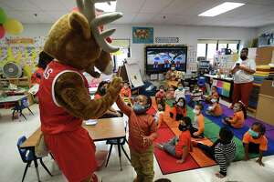 Fairfield University mascot Lucas visiits a Pre-K classroom during Bridgeport Read Aloud Day at Bryant Elementary School in Bridgeport on Wednesday.