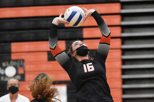 Edwardsville's Lexie Griffin sets a pass for a teammate during a Southwestern Conference match against Belleville West.