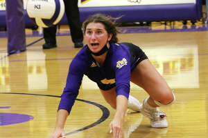 CM senior setter Maddie Brueckner dives to keep the play alive during last Tuesday's MVC volleyball match against Mascoutah in Bethalto.