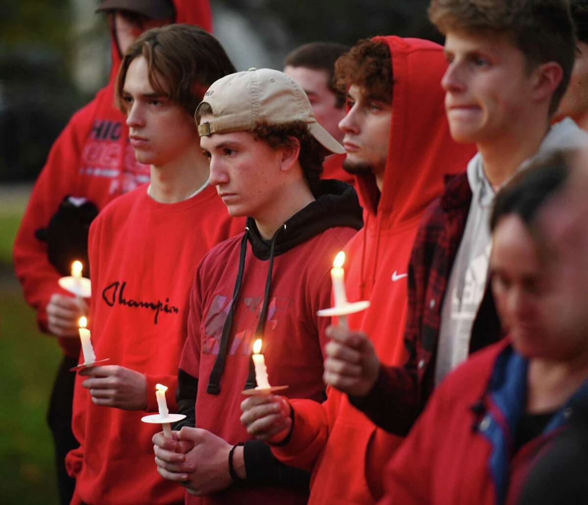 Friends and family attend the vigil for Colchester residents Jacob Chapman and Tyler Graham, both 18, at the Town Green in Colchester, Conn. Sunday, Oct. 24, 2021. Chapman and Graham, lacrosse players at Western Connecticut State University, were killed in a car crash in Colchester Friday afternoon. A third student, Trey Massaro, 19, of Dalton, Mass., was airlifted to Hartford Hospital with serious injuries.