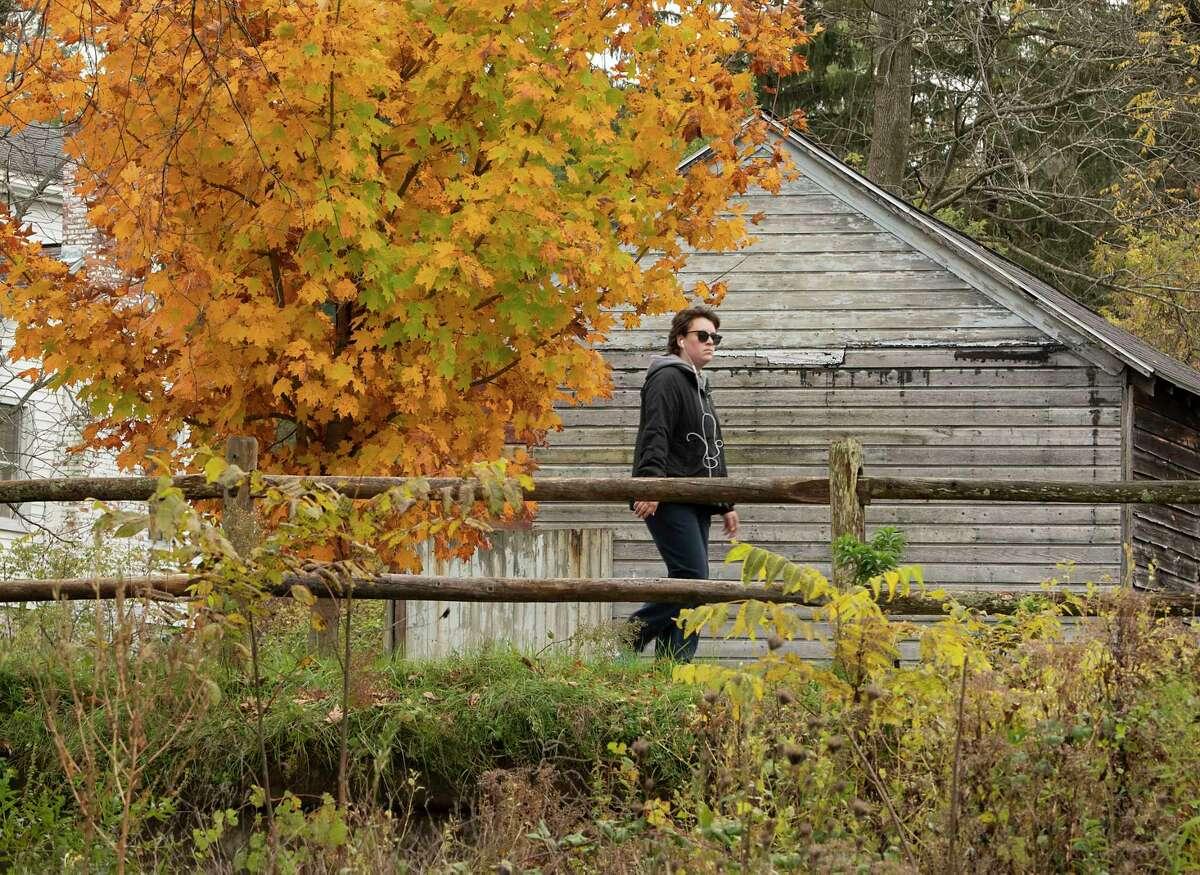 A pedestrian walks along the Mohawk-Hudson Bike Trail at Lions Park on Monday, Oct, 25, 2021 in Niskayuna, N.Y.