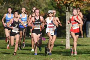 Trumbull's Evelyn Marchand (400), Ridgefield's Dirdre Flanagan (276), New Canaan's Radea Ralev (253) and Greenwich's Esme Daplyn (177) race in the FCIAC girls cross country championship in New Canaan's Waveny Park on Wednesday, Oct. 20, 2021.