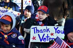 Milford, Connecticut - Saturday, November 9, 2019: Pack 7 Cub Scout Nate Browne (CQ), 7, of Milford salutes the reviewing stand during the annual Veterans Day Parade Saturday in downtown Milford organized by the Milford Veterans Ceremony and Parade Commission.