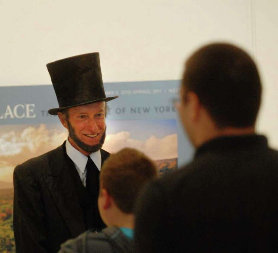 Re-enactor Phil Jessen from Hartford, NY, portrays Abraham Lincoln  at the New York State Museum in Albany, NY on Sunday, Sept. 19, 2010, during a public display of the handwritten copy of President Abraham Lincoln's  Preliminary Emancipation Proclamation.  The document is encased surrounded by nitrogen gas with special lighting to help protect the document from degrading.  The document is part of the New York State Library?s collection.  (Paul Buckowski / Times Union) Photo: Paul Buckowski / 00010303A