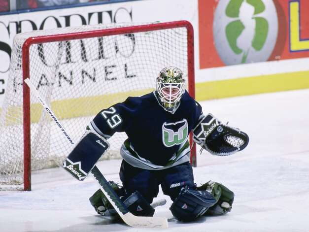 13 Feb 1997: Goaltender Jason Muzzatti of the Hartford Whalers looks on during a game against the New Jersey Devils at the Continental Airlines Arena in East Rutherford, New Jersey. The Devils won the game, 4-0. Mandatory Credit: Al Bello /Allsport