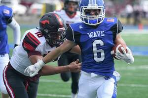 Darien's Matt Minicus (6) scores on a 33-yard touchdown pass from Miles Drake as Warde's Anwar Sakly (10) pursues during a football game in Darien on Sat., Sept. 11, 2021.