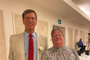 Midland's Jim Parker and Vivian Schaaf pose together at the USA Softball of Michigan Hall of Fame ceremony at The H Hotel on Oct. 2, 2021.