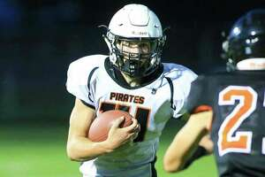 The Harbor Beach Pirates wrapped up the 2021 regular season with a 29-6 victory over host Unionville-Sebewaing on Friday night. The Pirates, who will travel to rival Ubly for a Week 1 playoff matchup, won four of their last five games and finish the regular season with a 6-3 record. Above, Pirates quarterback Tanton Babcock stares downUbly'sMarkHeilig during the Backyard Brawl in September. (Tribune File Photo)