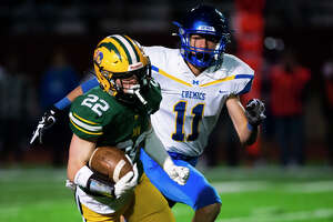 Dow High's Carter Kohtz carries the ball during last Friday's game against Midland High, Oct. 22, 2021.