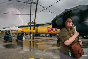Severe weather will threaten Houston on Wednesday morning as a cold front moves in. In this photo, a woman waits, in a thunderstorm, to view the Union Pacific Big Boy No. 4014 upon its arrival on August 16, 2021 in Houston, Texas.