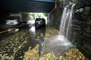 Heavy rain causes flooding under the train bridge in the Byram section of Greenwich, Conn. Tuesday, Oct. 26, 2021. A nor'easter hit the area Tuesday with heavy rain causing flooding and downed trees.