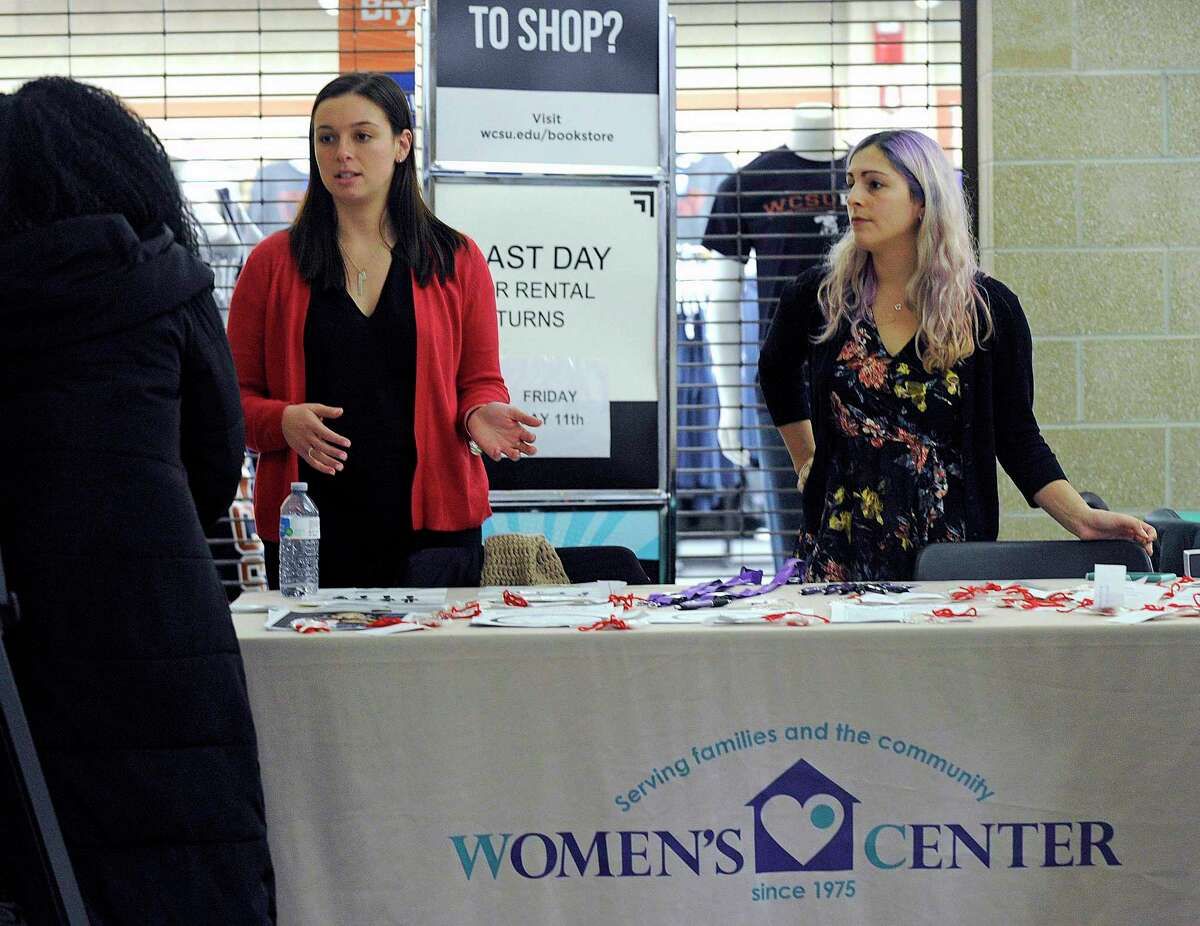 Sydney Trezza, of New Milford, left, a campus advocate for the former Women's Center of Greater Danbury and Cara Mackler, of Danbury, a prevention educator, conduct a healthy relationship awareness program at Western Connecticut State University in this photo from 2018. The nonprofit has rebranded itself as the Center for Empowerment and Education to better reflect the depth and breadth of its services.