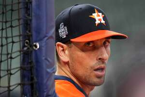 Houston Astros catcher Jason Castro watches during batting practice before Game 1 in baseball's World Series against the Atlanta Braves Tuesday, Oct. 26, 2021, in Houston. (AP Photo/David J. Phillip)