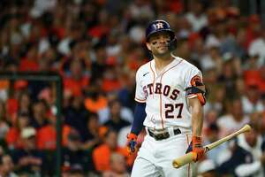 Houston Astros second baseman Jose Altuve (27) walks back to the dugout after striking out to leadoff the first inning in Game 1 of the World Series on Tuesday, Oct. 26, 2021 at Minute Maid Park in Houston.