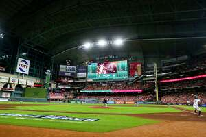 Atlanta Braves starting pitcher Charlie Morton (50) pitches to Houston Astros second baseman Jose Altuve (27) during the first inning in Game 1 of the World Series on Tuesday, Oct. 26, 2021 at Minute Maid Park in Houston.