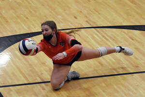 Edwardsville's Rachel Heflin makes a diving attempt on the ball in the first set against the Granite City Warriors on Tuesday in a Class 4A regional semifinal match.