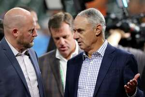HOUSTON, TEXAS - OCTOBER 26: Major League Baseball Commissioner Rob Manfred (R) talks with General manager James Click (L) of the Houston Astros prior to Game One of the World Series between the Atlanta Braves and the Houston Astros at Minute Maid Park on October 26, 2021 in Houston, Texas.