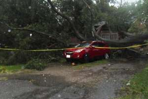 A tree fell on a home along Airway Drive in north Harris County on Wednesday, Oct. 27, 2021.