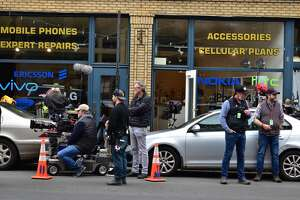 """Film crew at the shooting of the Netflix movie """"Mr. Harrigan's Phone,"""" a Stephen King adaptation, in South Norwalk's Washington Street on Oct. 27, 2021."""