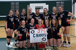 Beaverton's volleyball team poses with its trophy after finishing unbeaten in Jack Pine Conference play for the third straight year following wins over Farwell, Harrison, and Pinconning on Wednesday, Oct. 27, 2021.