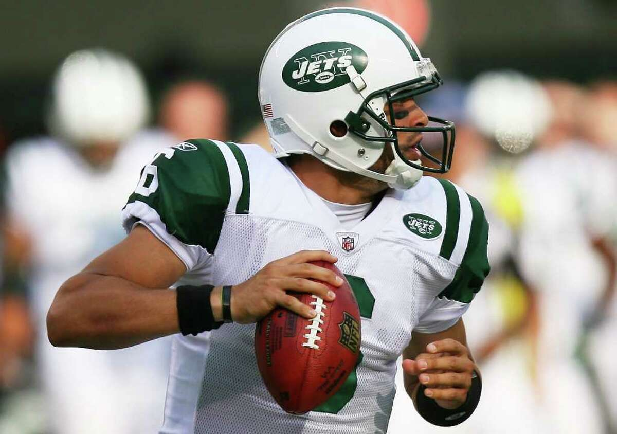 EAST RUTHERFORD, NJ - SEPTEMBER 19: Mark Sanchez #6 of the New York Jets drops back against the New England Patriots at the New Meadowlands Stadium on September 19, 2010 in East Rutherford, New Jersey. (Photo by Andrew Burton/Getty Images) *** Local Caption *** Mark Sanchez