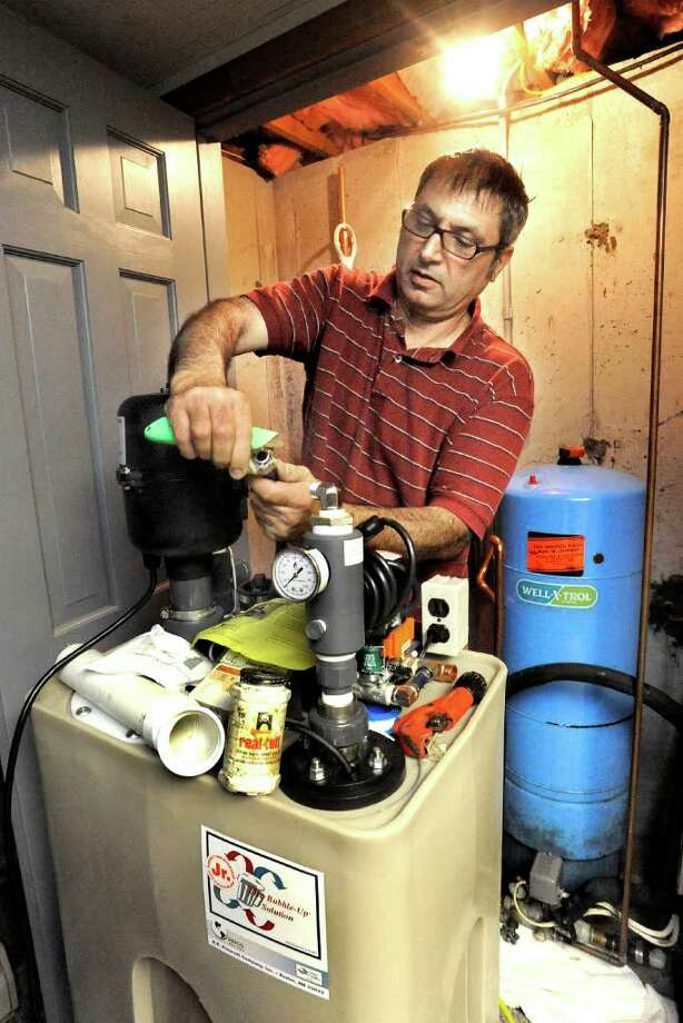 Peter Piller, Jr., of American Home Radon Services, installs a radon water aeration unit in a Brookfield home, Friday, Sept. 17, 2010. Photo: Michael Duffy / The News-Times
