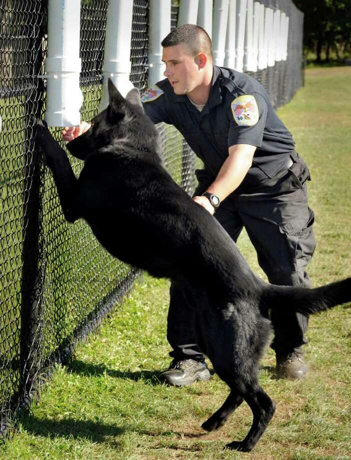 Danbury Police Officer Greg Topa teaches Zeke how to sniff out narcotics. Zeke, a 22-month-old pure German shepherd, is the department's first canine in more than a year. Photo taken Monday, Sept. 20, 2010. Photo: Carol Kaliff / The News-Times