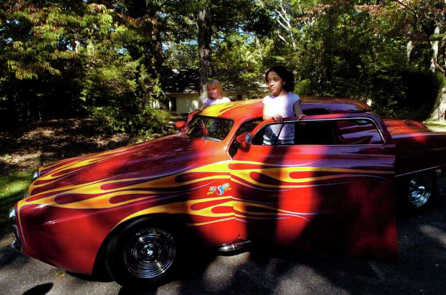 Claudia Geyer and her friend Katherine Briggs play at Claudia's home on  White Fox Rd in Stamford, Conn. on Monday September 20, 2010 in the 1951 Studebaker that Robert Geyer, Claudia's dad, restored. Photo: Dru Nadler / Stamford Advocate Freelance