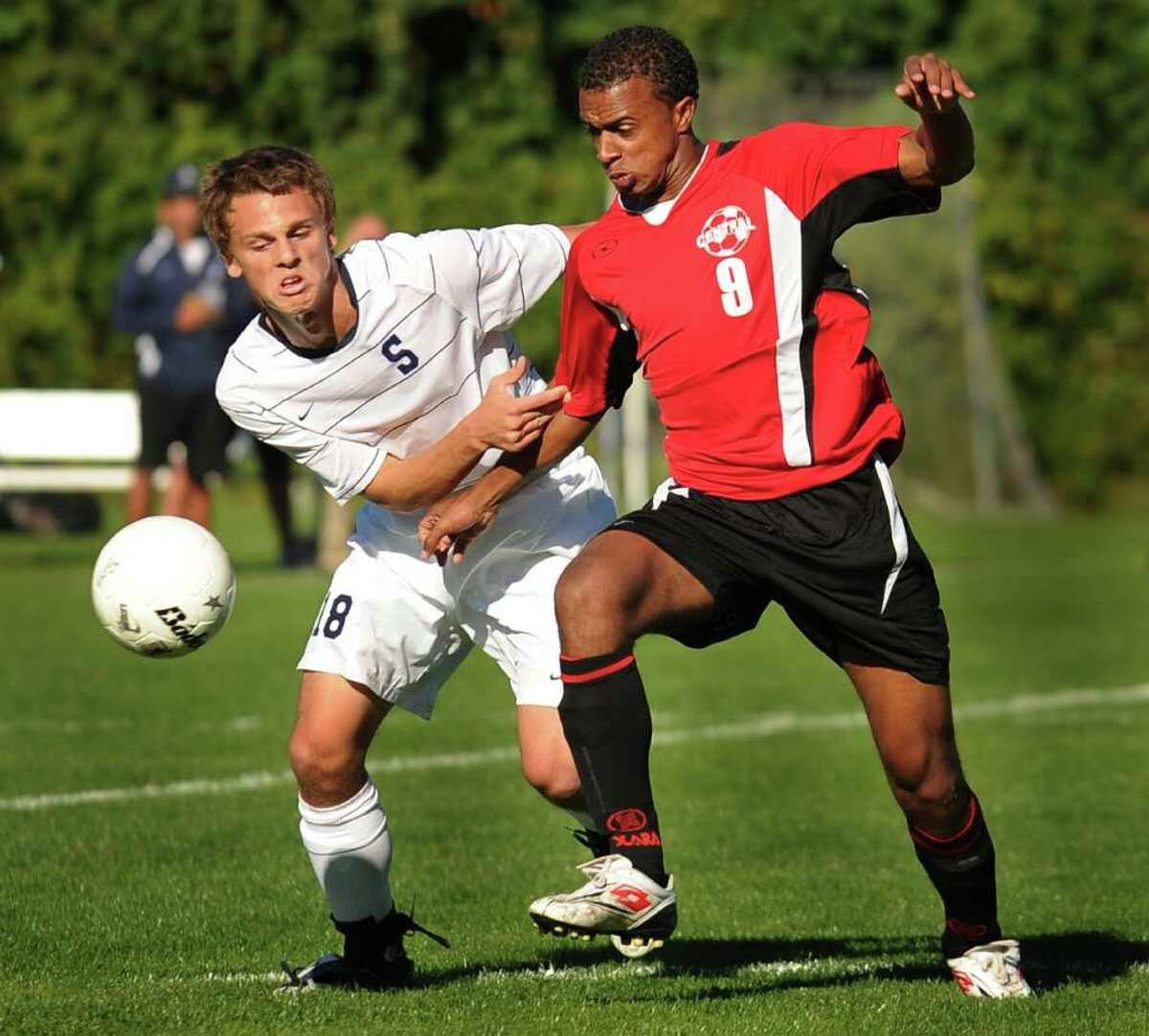 Staples' Steven Denowitz, left, and Bridgeport Central's Antonio DaGraca, play the ball during their FCIAC boys soccer matchup at Staples High School in Westport on Monday, September 20, 2010.