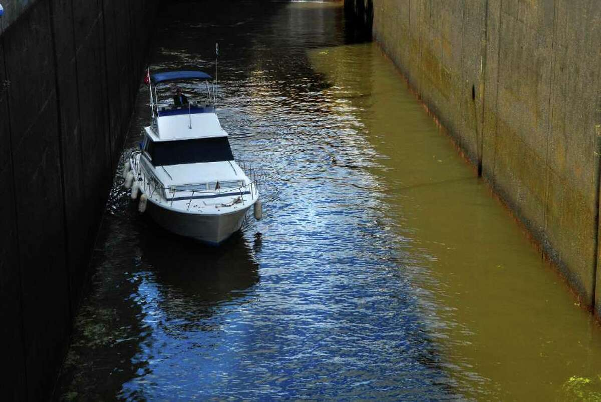 A boat is piloted out of Lock 7 on the Erie Canal in Niskayuna, NY on Monday, Sept. 20, 2010. (Paul Buckowski / Times Union)