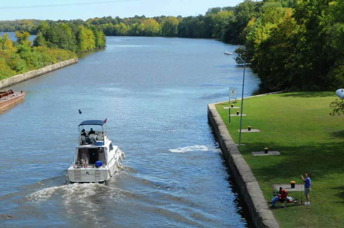 A boat is piloted out of Lock 7, heading east on the Erie Canal in Niskayuna, NY on Monday, Sept. 20, 2010. (Paul Buckowski / Times Union)
