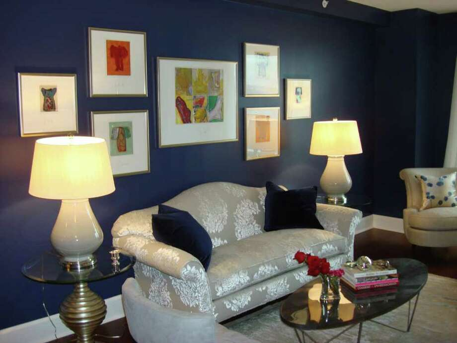"""Sofa covered in raised silver gray cut velvet, with a collection of """"Strappo"""" kimonos hung above it. Photo: Contributed Photo / Connecticut Post Contributed"""