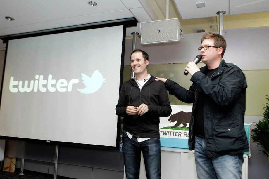 Twitter co-founder Biz Stone, right, talks next to CEO Evan Williams about changes to the social network at Twitter headquarters in San Francisco,  Tuesday, Sept. 14, 2010. Twitter was hacked on Monday, with users unwittingly resending messages and referring followers to Internet porn sites. (AP Photo/Marcio Jose Sanchez) Photo: Marcio Jose Sanchez, AP / AP