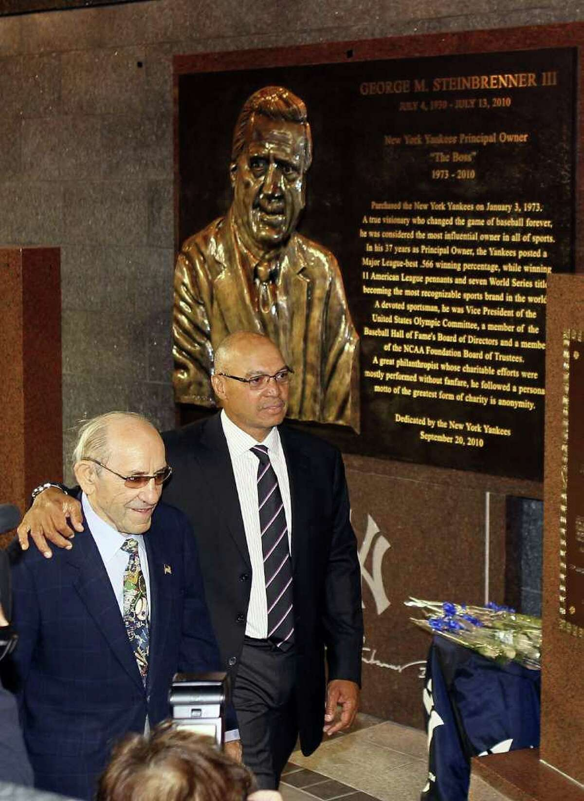 NEW YORK - SEPTEMBER 20: New York Yankees Hall of Famers Yogi Berra (L) and Reggie Jackson walk past the monument to the late owner George Steinbrenner prior to a game against the Tampa Bay Rays on September 20, 2010 at Yankee Stadium in the Bronx borough of New York City. (Photo by Jim McIsaac/Getty Images) *** Local Caption *** Yogi Berra;Reggie Jackson