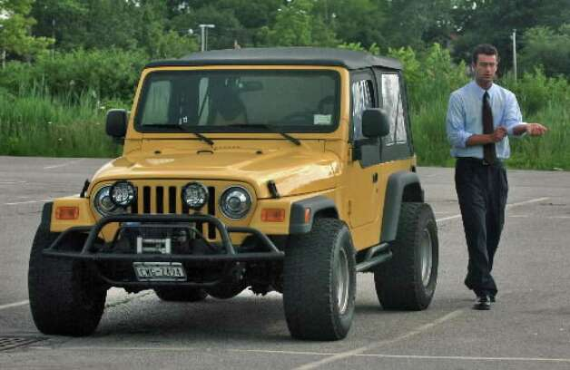 Christopher Porco gets into his yellow Jeep at the end of the day's court session at the Orange County Courthouse in Goshen in July 2006. ( Times Union archive / Philip Kamrass )