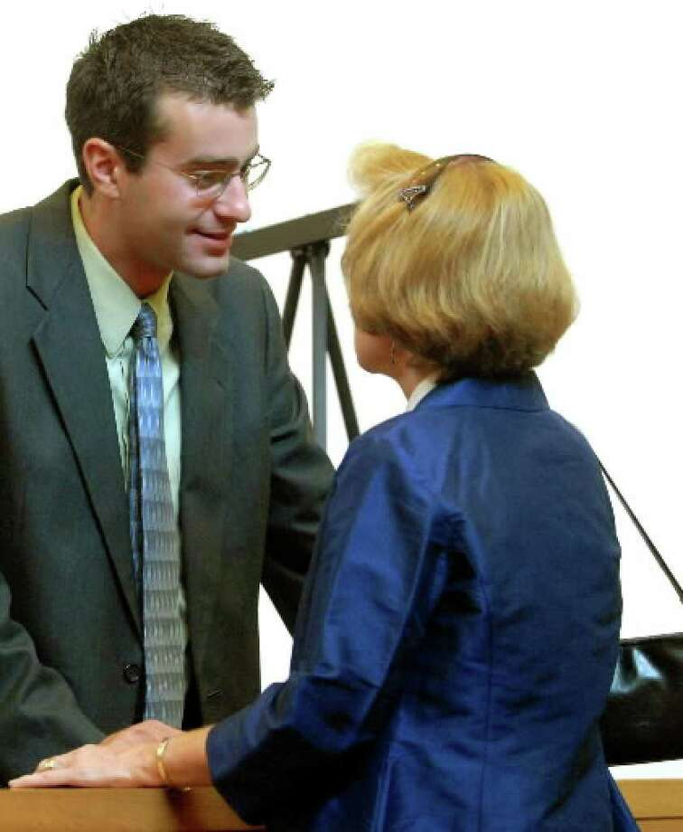 Christopher Porco and his mother, Joan Porco, talk at the Orange County Courthouse in Goshen during his trial in 2006. ( Michael P. Farrell / Times Union archive )