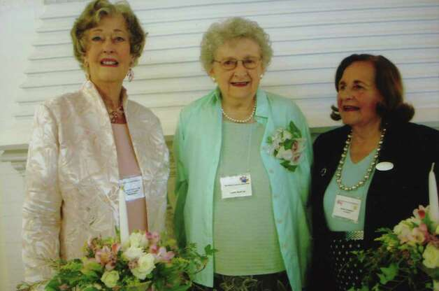 Irene Martin, center, holds the honor of being the longest-time member of the Woman's Club of Greenwich.  She has been in the club for more than 50 years. At left is most recent past-president Valerie Anderson, who served in that post from 2008 through June of this year, and on right is Marie Krumeich, who served as president of the club from 2006-2008. Photo: Contributed Photo / Greenwich Citizen