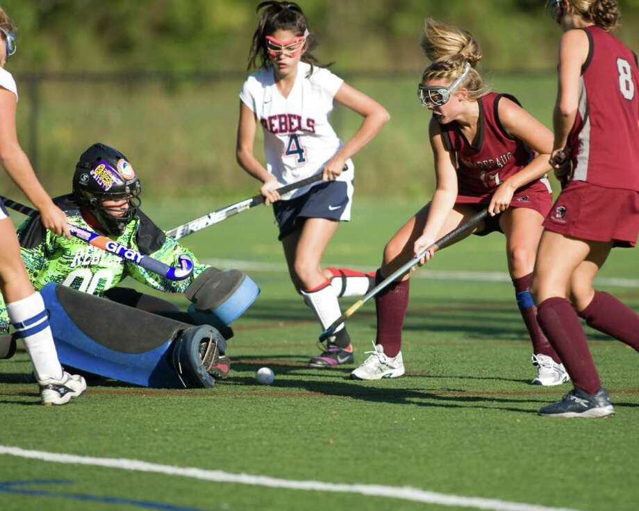 Pomperaug's Kathryn Walker (17) pounces on a rebound in front of New Fairfield goalie Marisa Remley which led to the Panthers' first goal Tuesday at New Fairfield High. Photo: Barry Horn / The News-Times Freelance