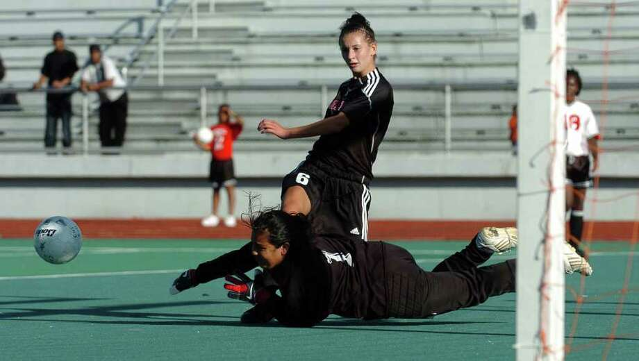 Central's goalie Carolina Forero deflects a goal attempt by Fairfield Warde's #6 Cate Allen, during soccer action at Central High School in Bridgeport, Conn. on Tuesday September 21, 2010. Photo: Christian Abraham / Connecticut Post